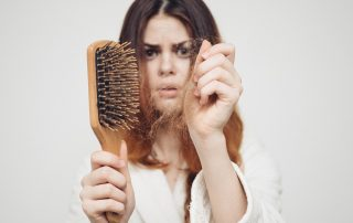 Why is my hair falling out? - a woman wondering about causes of hair loss in women
