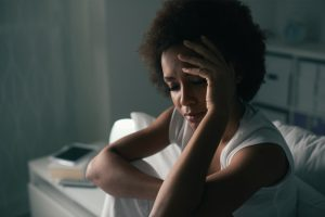 a woman unable to sleep due to restless legs syndrome