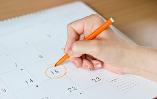 a woman who has irregular periods, marking the date in her calendar, wondering about causes of irregular bleeding